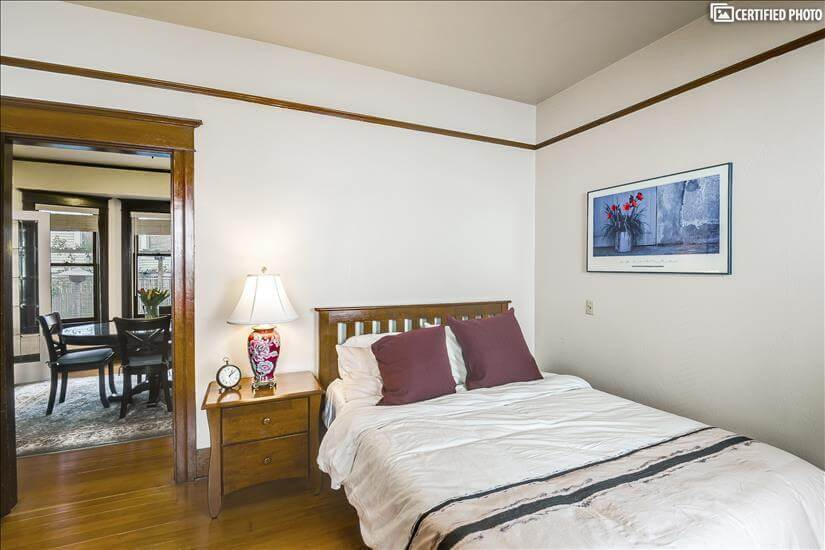 Bedroom with queen size Puffy Lux mattress fo