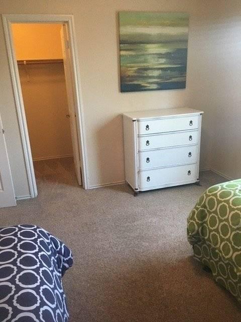 Bedroom #3 has a dresser and walk-in closet