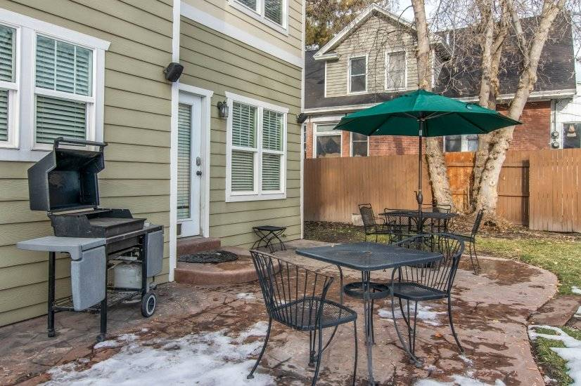 Private patio with table, barbecue