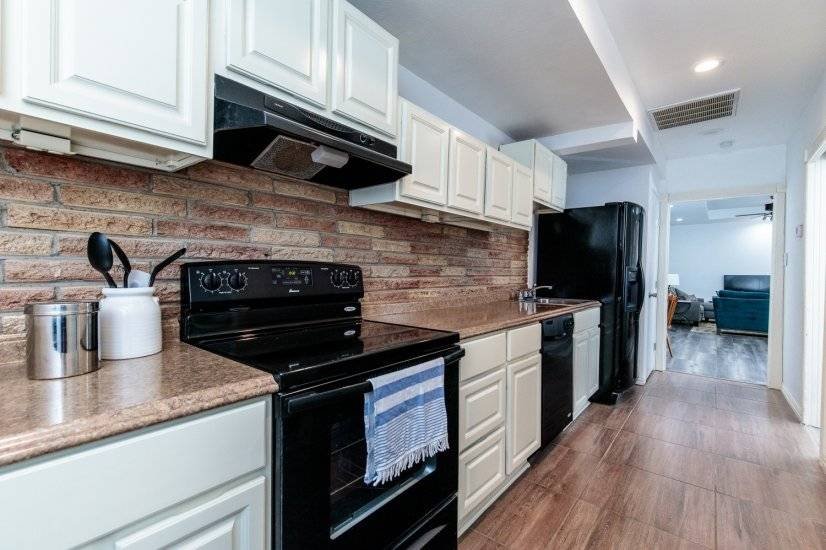 Kitchen to dining and living.