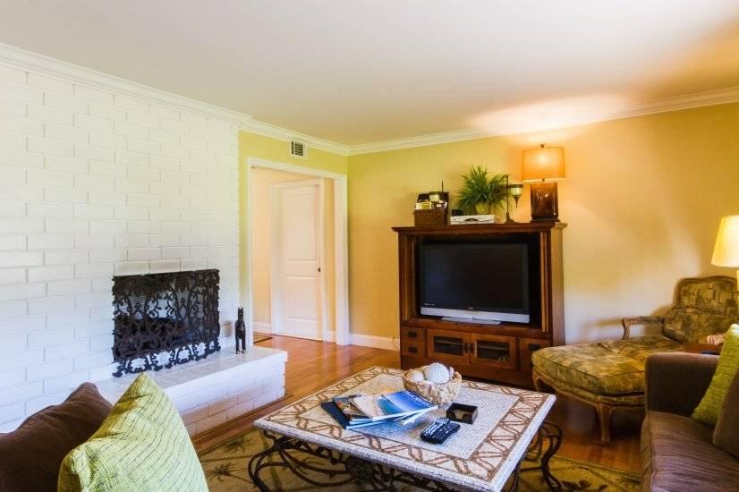Comfortable Living room, large flat screen TV, wood floors