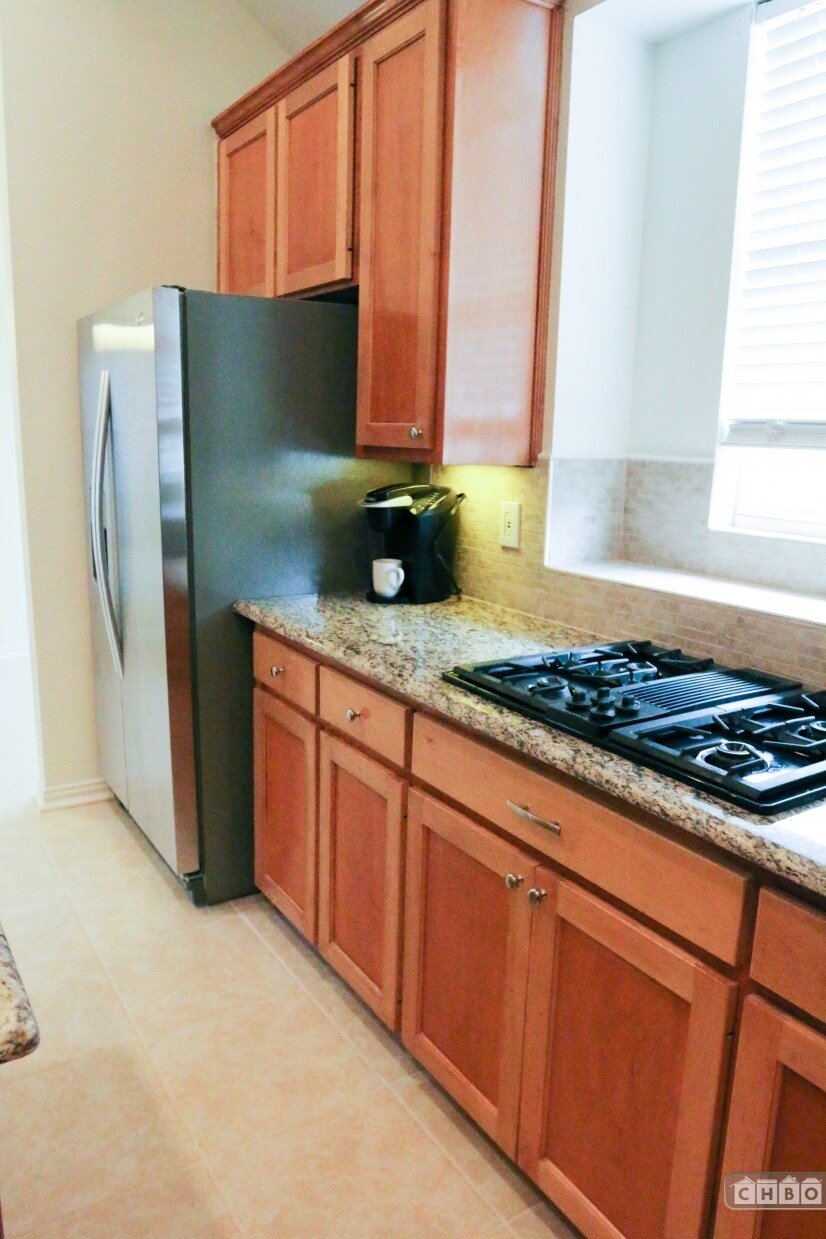 Gas stove and large stainless refrigerator