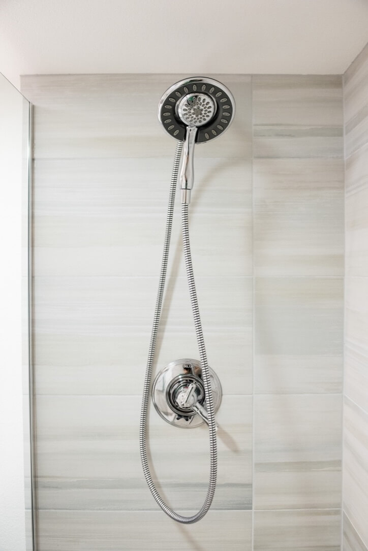 Multi setting spa shower head • awesome water pressure.