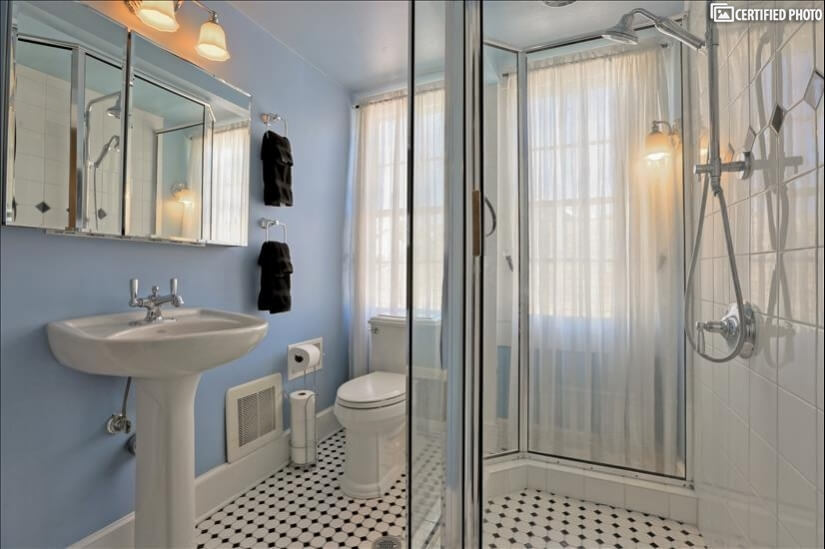 Bright bath with stand alone shower in Royal Quarters