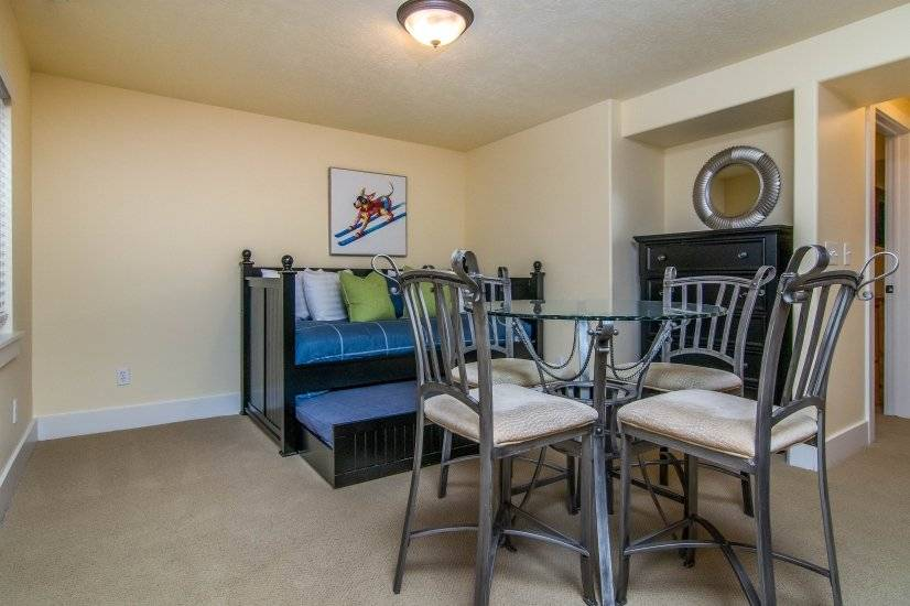Basement Family Room with day bed and dining table