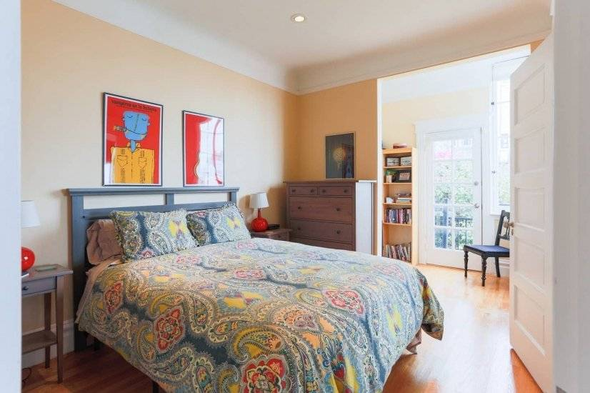 2nd Queen bedroom with abundant natural light & original art