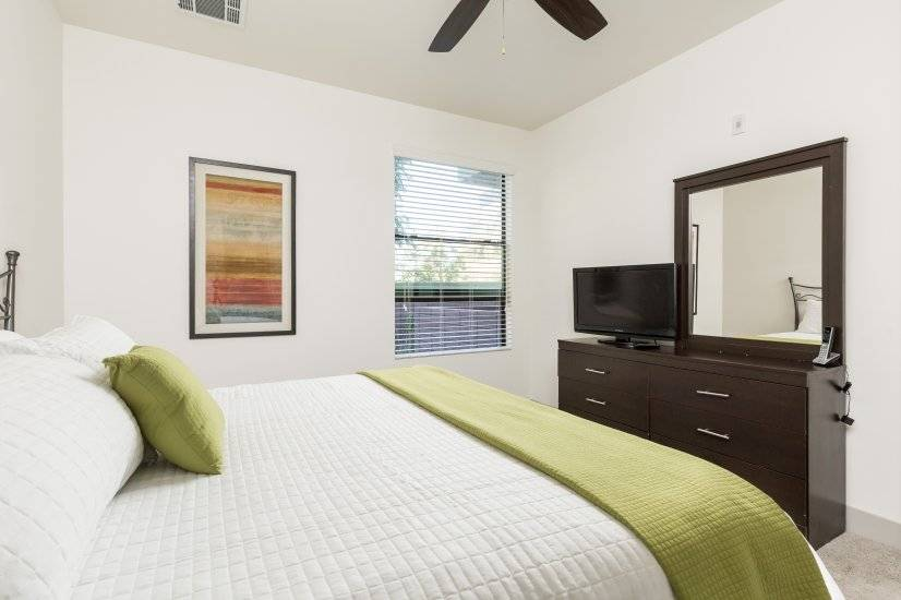 Master Bedroom - King sized bed w/ TV w/ Roku and Dresser