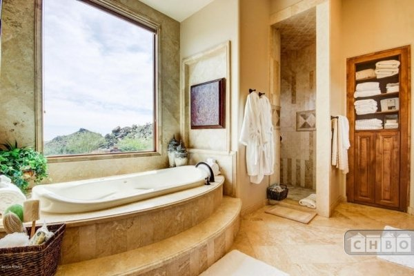 Master bathroom with walk-in shower, tub, steam room and thr