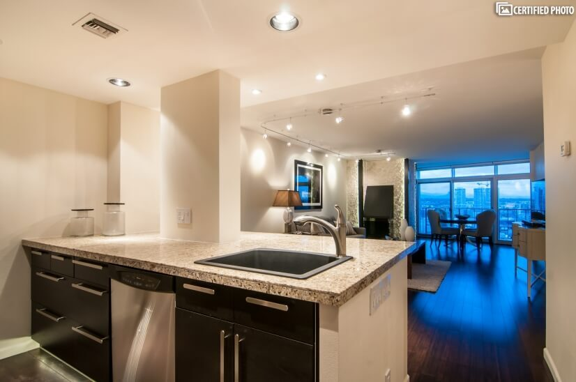 Open floor plan shows kitchen, living & dinin
