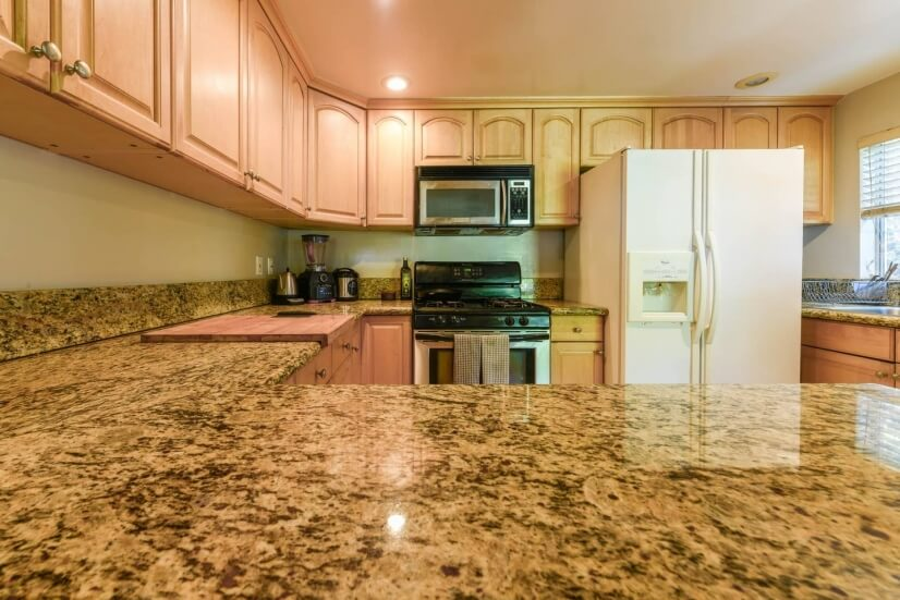Kitchen with granite countertops, dishwasher