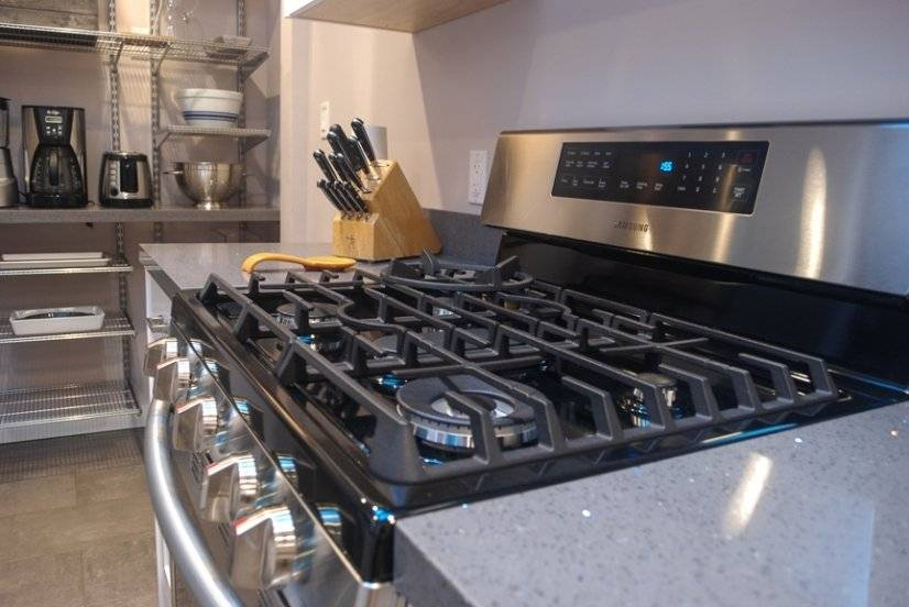 Well appointed kitchen with 5-burner standard-size gas stove