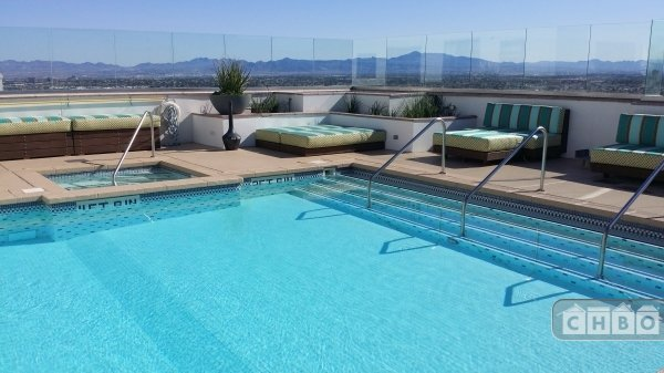 Rooftop pool steps from unit