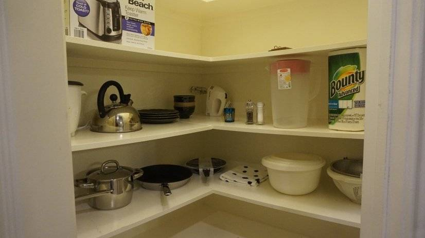 Panty stocked with Pots, Pans,Kettle, Toaster etc.