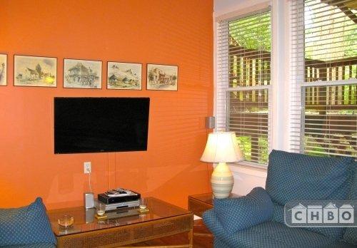 Living room has flat screen TV, DVR, DirecTV and very comfy