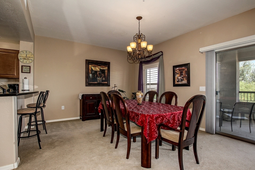 FORMAL DINING AREA WITH BREAKFAST BAR