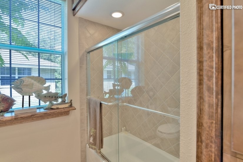 Shower/tub area with window in conference room area.