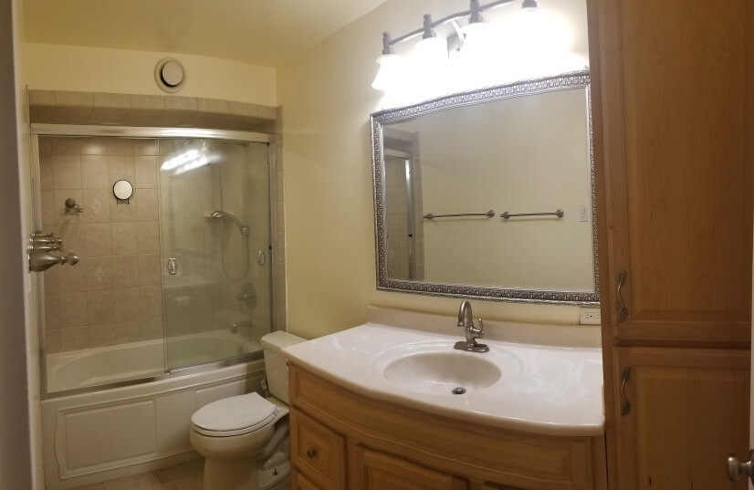Large bathroom with soaking tub and storage