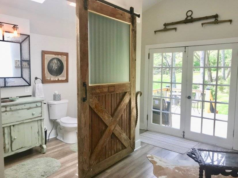 Full bathroom, sitting area, overlooking private back deck.