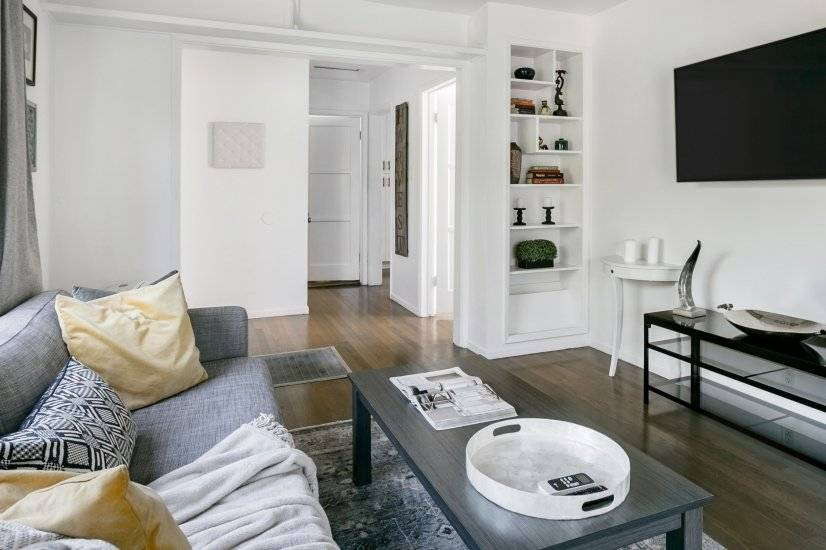 Living room with gray-washed refinished hardwood floors