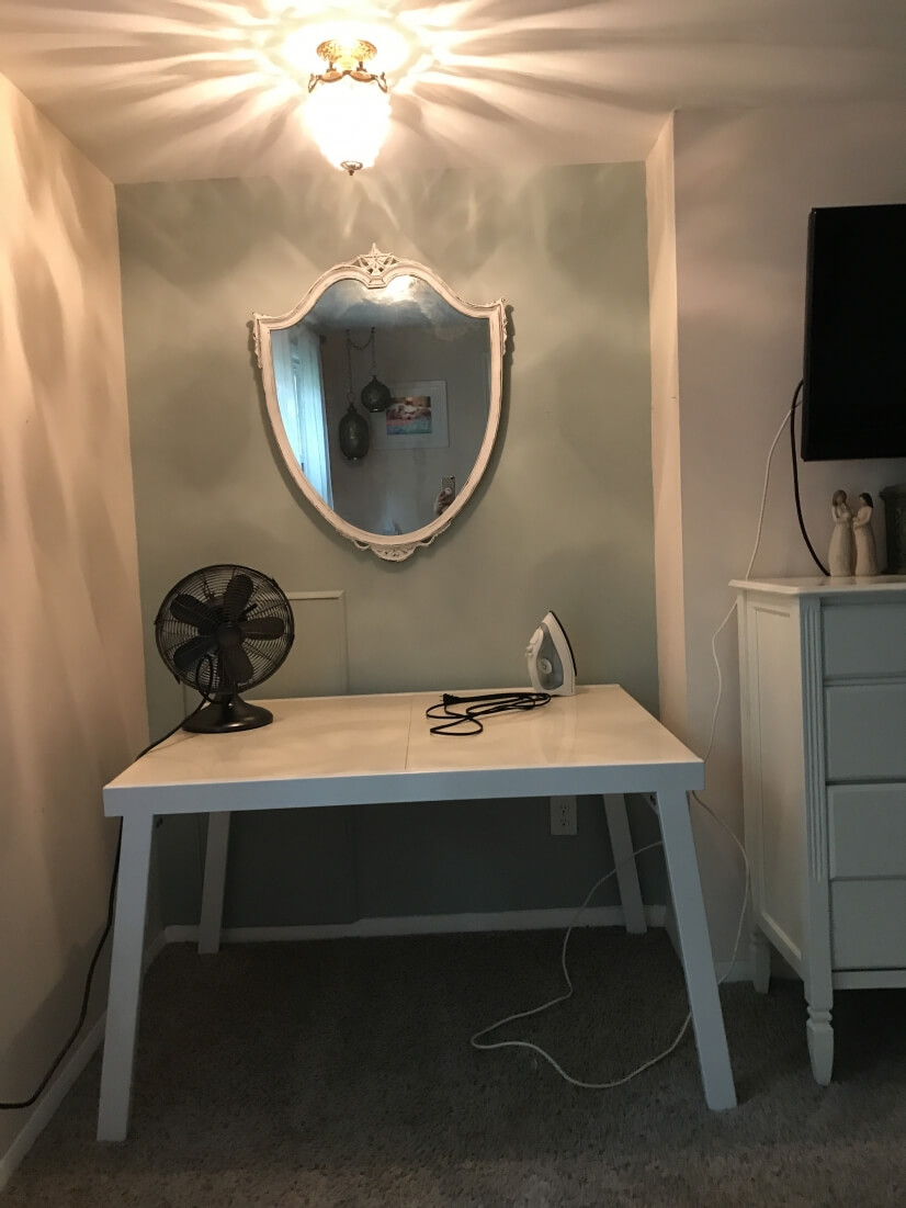 Ironing/work/office space in master bedroom