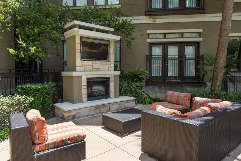 outdoor fireplace and tv by the pool