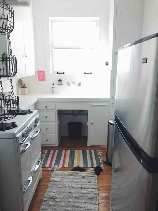 Kitchen with vintage stove, handmade pottery