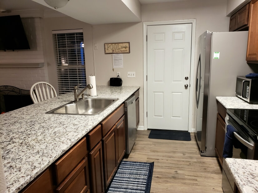 kitchen has 2 bar stools and open concept