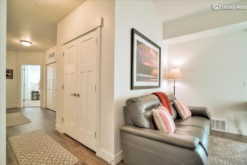 Wide hallway with storage.