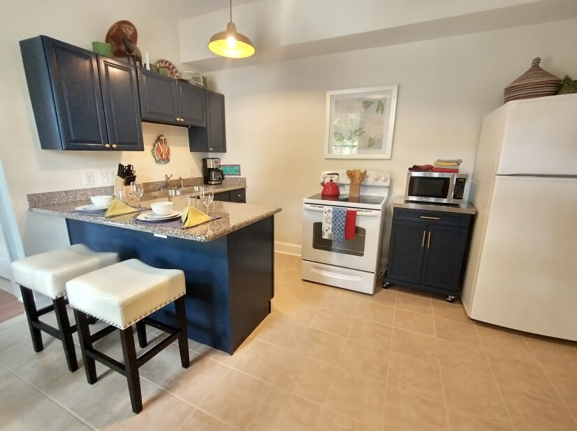 Fully stocked kitchen with electric range.