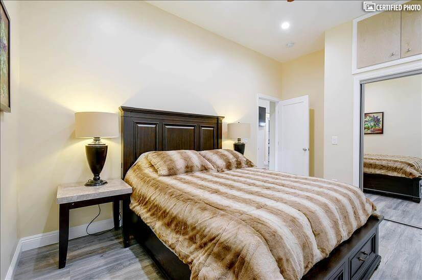 Queen size bed with storage in master bedroom 2