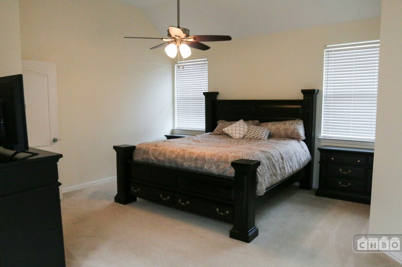 Master bedroom with huge king bed with built in storage
