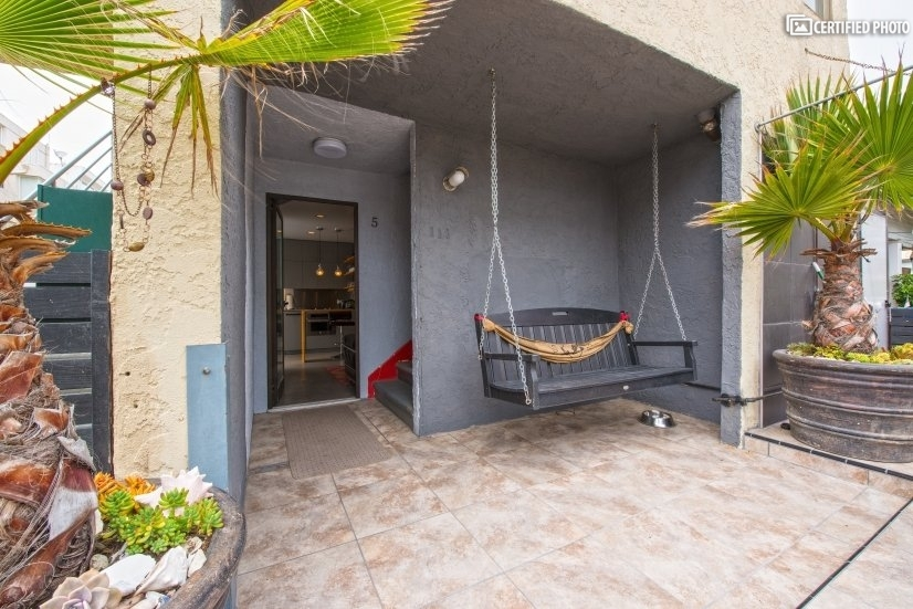 Enter the apartment through the patio.