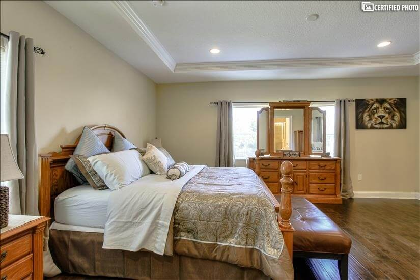Cavernous master bedroom with classic bedroom set