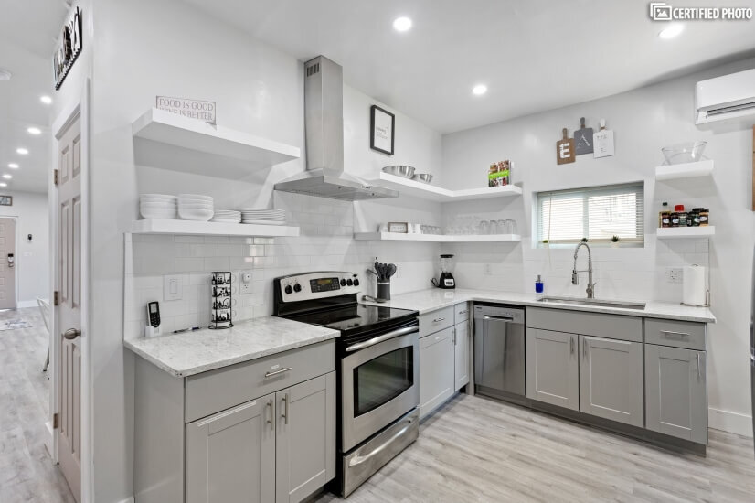 Quaint Kitchen complete with dishware, cookware & utensils