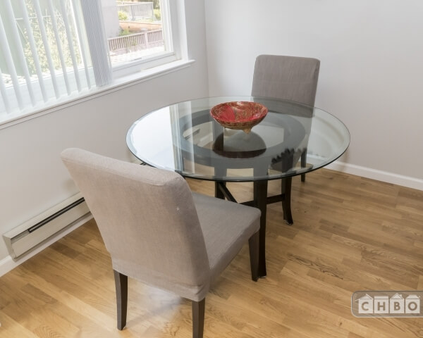 Glass dining table & comfortable chairs