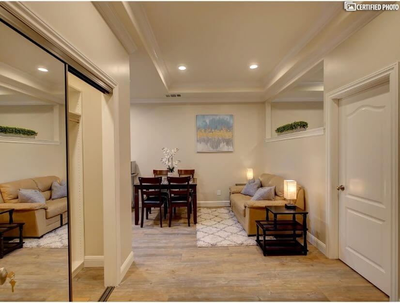 Suite D - Large living room with spacious entry area.