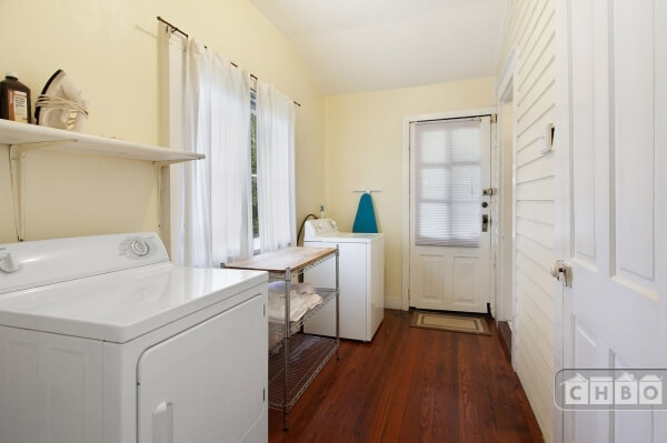 Laundry room with High Efficiency washing machine.