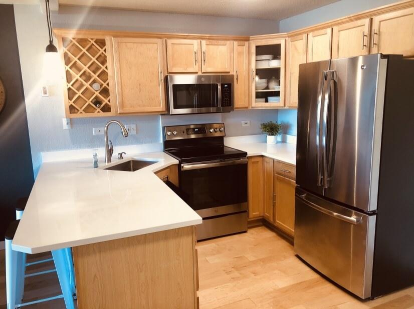 Modern kitchen with quartz countertops.