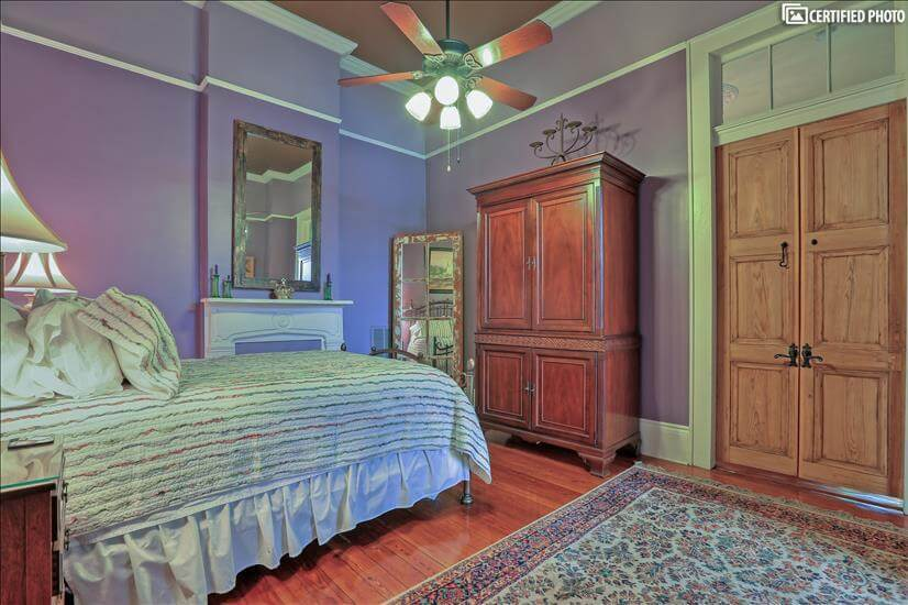 A colorful bedroom with cheerful New Orleans charm