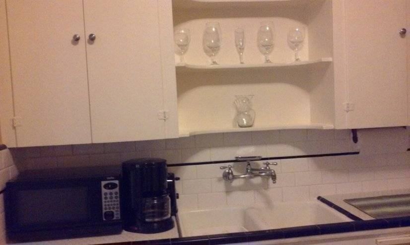 Microwave, coffee maker, toaster, crockpot, dishware