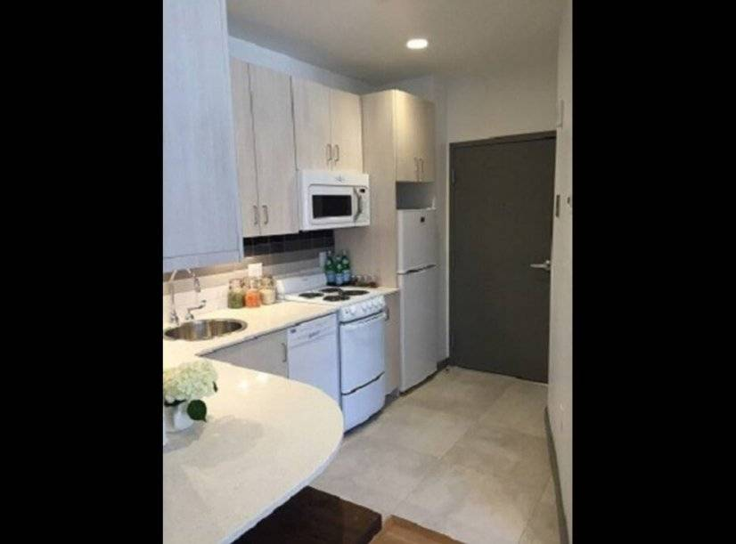 Granite counters with stove, dishwasher, built in microwave.
