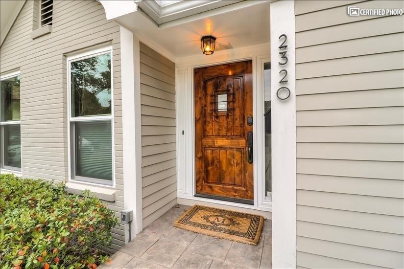 Entrance Door - Solid Wood and Peek out window on the door.