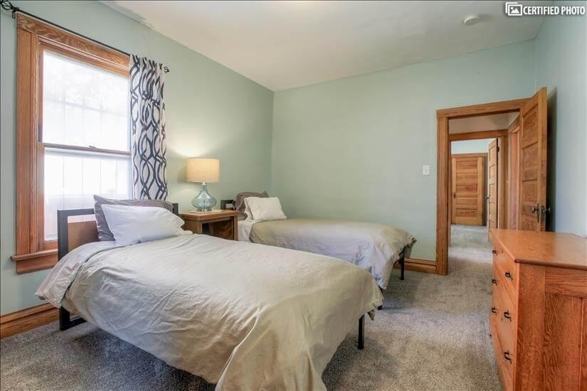 Two extra-long twin beds, door to hallway