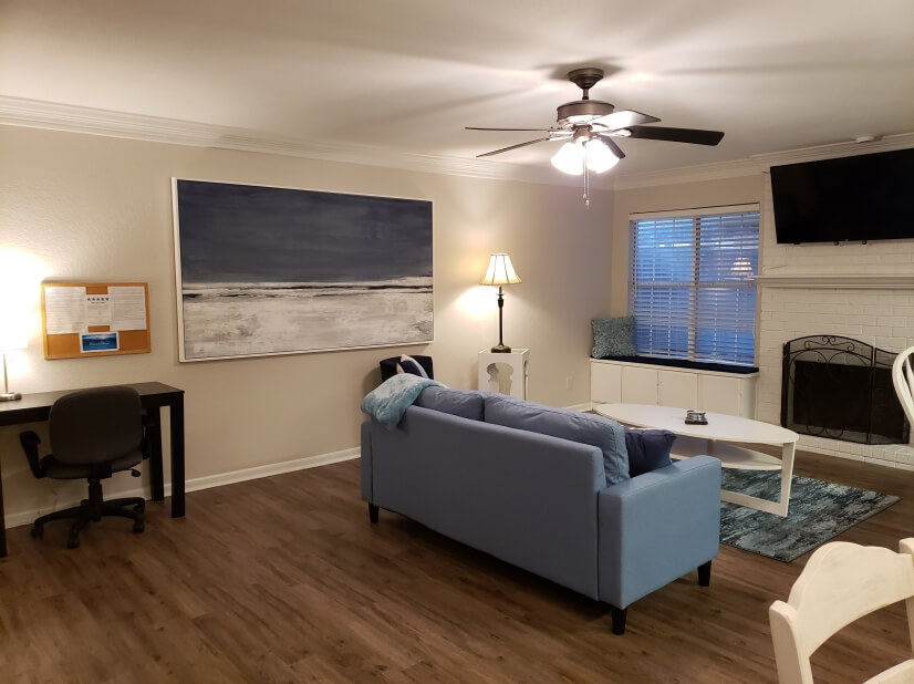 Living room has separate desk area, fireplace, open concept