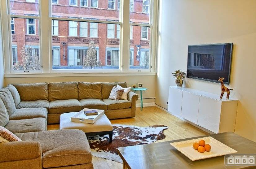 Spacious Living Area w/ Views On To 16th St. Mall