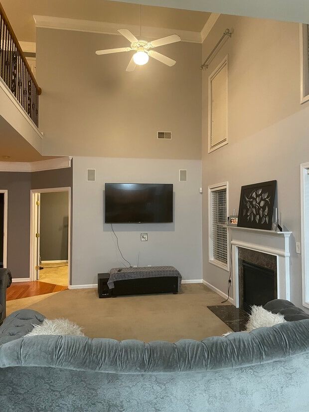 Living room with fireplace tall ceilings