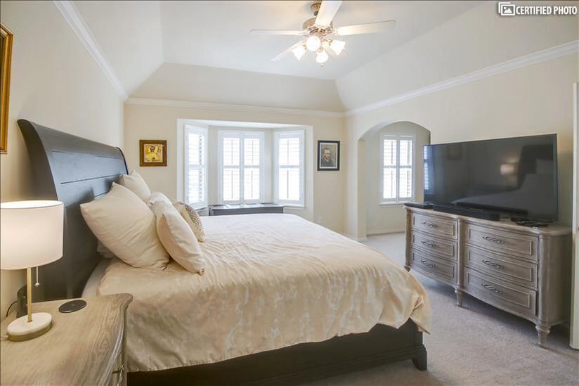 Brightly lit master bedroom