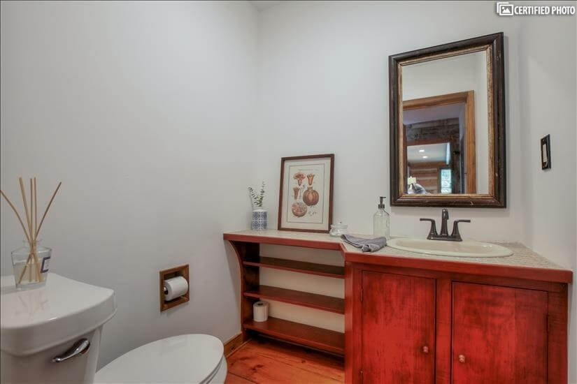 Half Bathroom located in hallway.