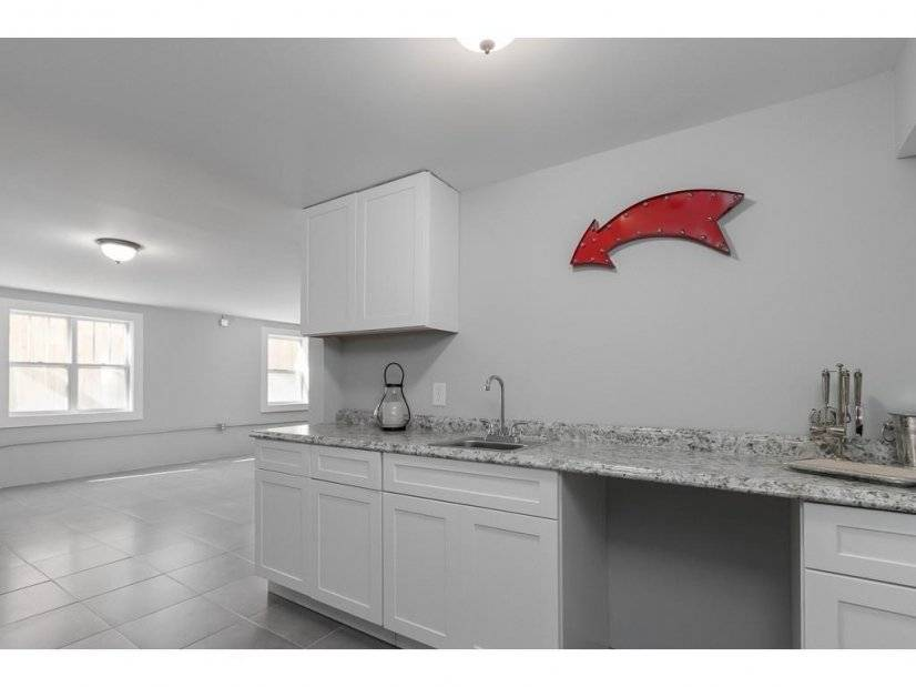 Basement bedroom with small kitchette sink area- wet bar?