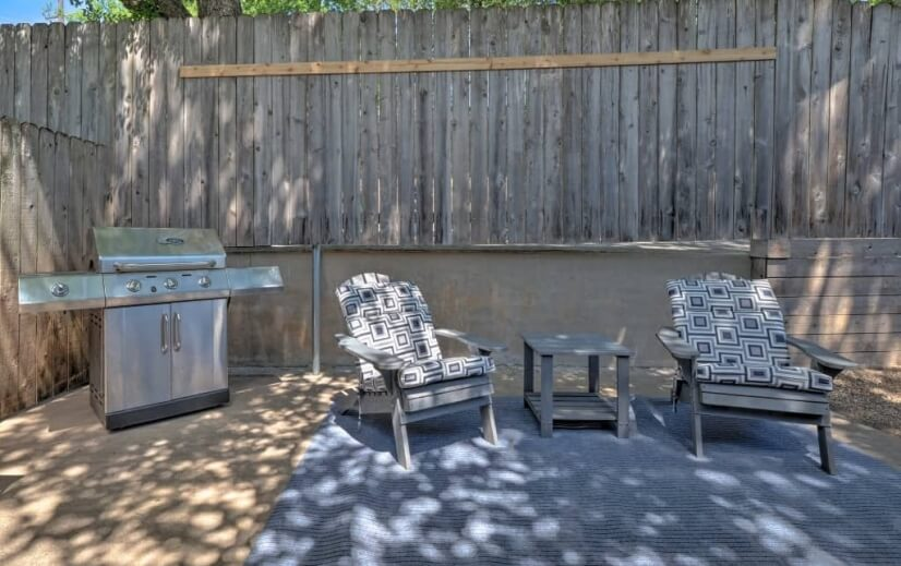 Backyard patio includes gas grill for an outd
